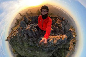 Jasper Zhou in a panoramic fisheye photo on top of Spencer Butte